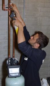 Bryant Plumber installing a water softener